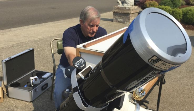 amateur astronomer Mike Conley practices with the telescope