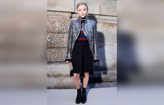 Chloe Grace Moretz in hiking boots, and funky outfit on the red carpet.