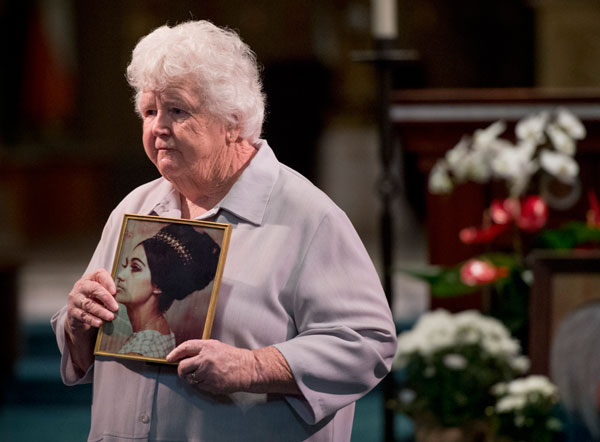 Sister Claire Graham, who attended St. Francis High with Genevieve Lucchesi, holds a picture of her as she remembered her when they were young.