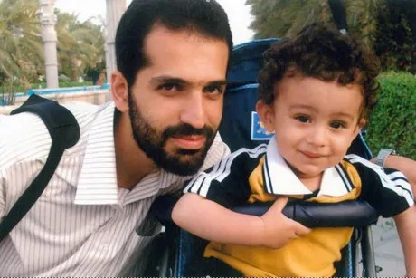 This undated photo released by Iranian Fars News Agency, claims to show Mostafa Ahmadi Roshan, who they say was killed in a bomb blast in Tehran, Iran, on Wednesday, Jan. 11, 2012, next to his son.