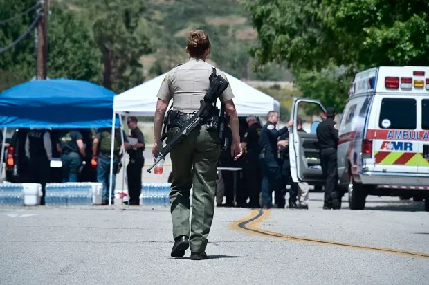 An armed officer following the San Bernardino school shooting