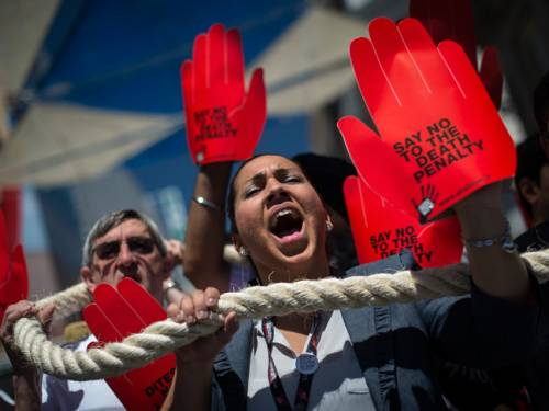 Demonstrators protest against the death penalty at the 5th World Congress against the Death Penalty in Madrid. (Getty)