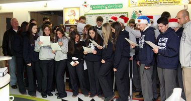 Sea basketball teams sing for kids in hospital
