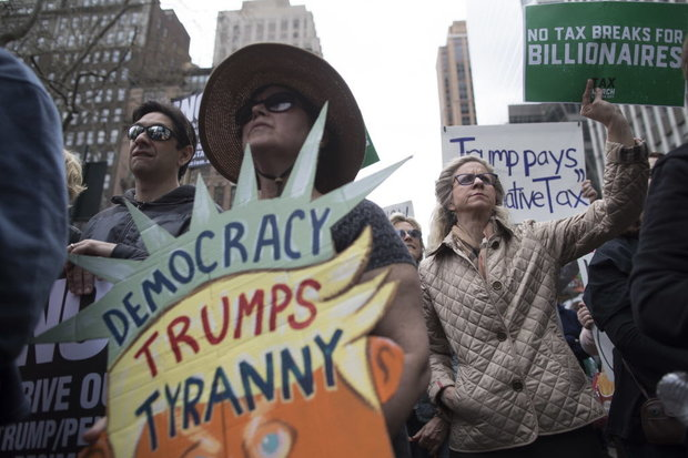 Image result for Nationwide Tax Day Marches Demand Donald Trump Releases His Tax Returns