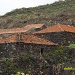 Traditionella hus byggda av lavasten. Las Manchas