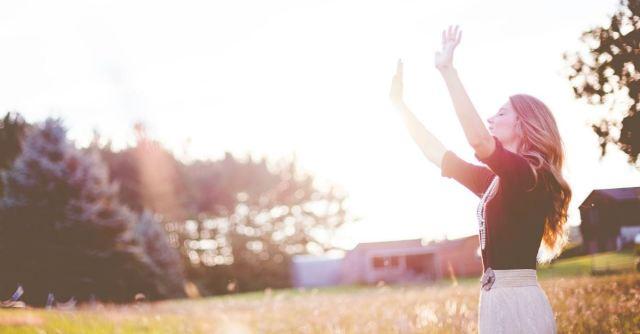 Lady lifting up hands, worshiping