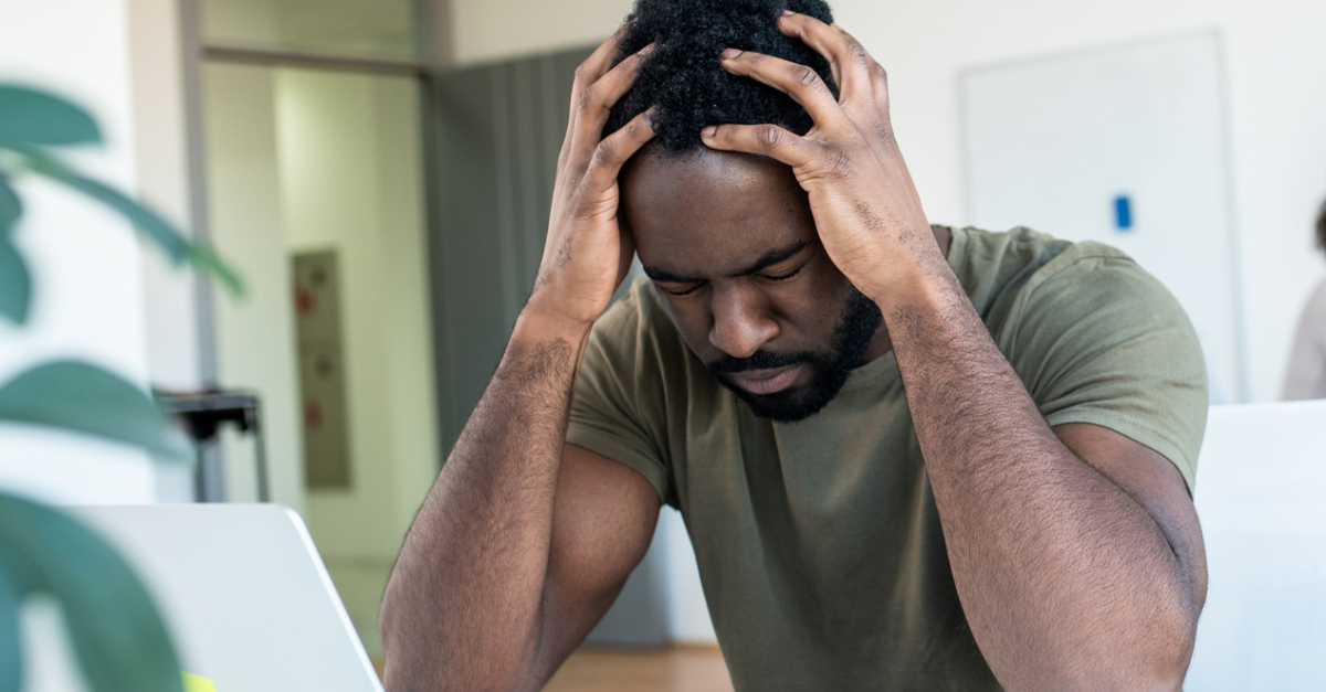 stressed at work man holding head in hands overcome anxiety, shame undermines marriage