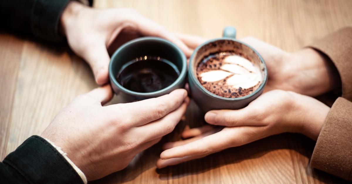 coffee cups hands date, dating decisions scripture guide