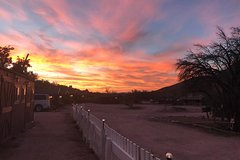 Sunset Cowboy Cabin Adventure from Las Vegas with Horseback or Wagon Ride