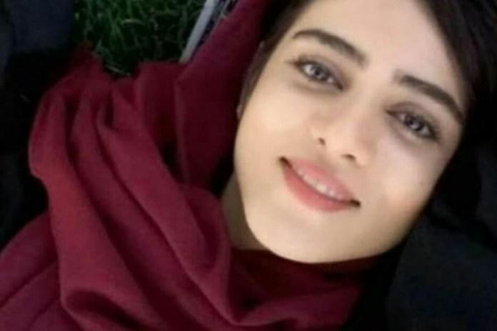 Sahar smiles into the camera.