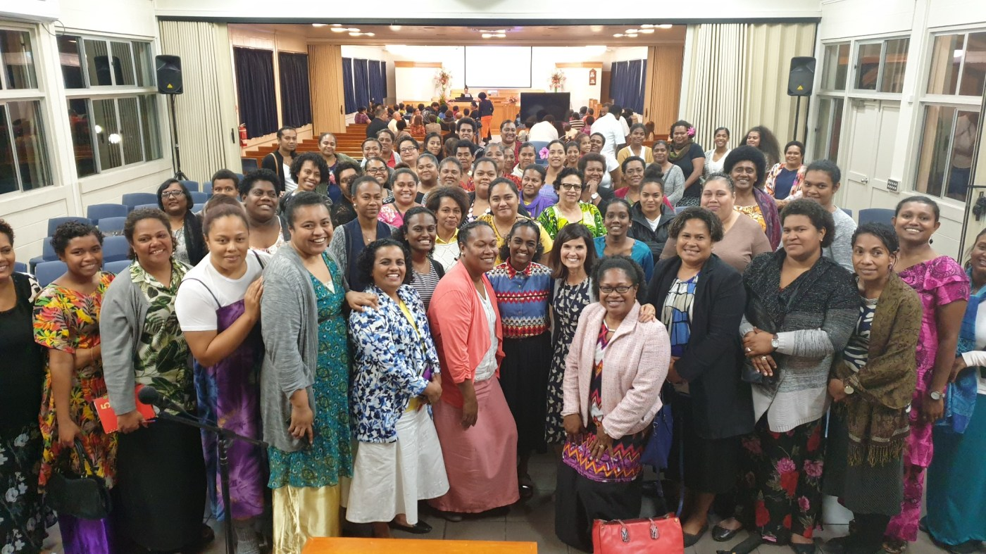 Sister Becky Craven, center right, poses with a group of women following a devotional in Fiji. Sister Craven visited Fiji with Sister Sharon Eubank during a trip to the Pacific Area in October 2019.