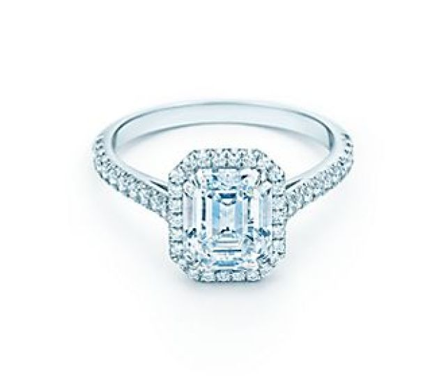 A Dazzling Center Stone Surrounded By A Luminous Halo Of Bead Set Diamonds