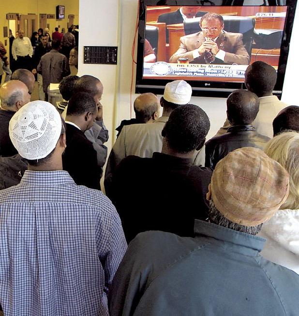 Opponents of an anti-terrorism bill watch a TV monitor in the legislative office complex as Rep. Rick Womick, R-Murfreesboro, discusses the bill in Nashville on Tuesday. Hundreds came to the Capitol to protest the measure that originally sought to make it a felony to follow some versions of the Islamic Sharia code. The measure has since been stripped of any reference to religion, but opponents say it is still unnecessary. (AP Photo/Erik Schelzig)