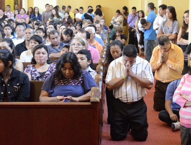 Spanish language Mass at the St. Joseph Catholic Church in Dalton, Ga., is attended by an overflow crowd.
