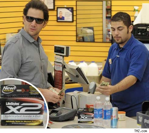 Image result for guy buying condoms