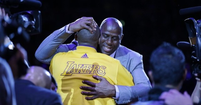 Los Angeles Lakers forward Kobe Bryant, left, hugs Magic Johnson during a ceremony before Bryant's last NBA basketball game, against the Utah Jazz, Wednesday, April 13, 2016, in Los Ang