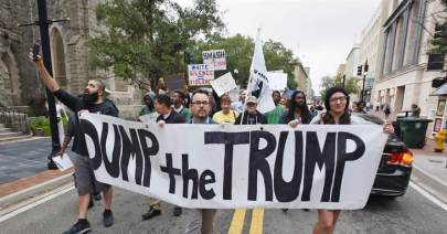 Anti-Trump protesters start their hike from Hemming Park to their announced destination at the offices of The Florida Times-Union newspaper, Saturday, Nov. 12, 2016, in Jacksonville, Fl