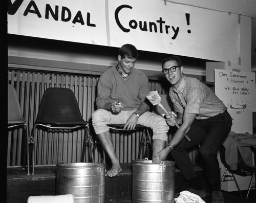 SUI President Jim Johnston bathes the blistered fee of ASWSU President and champion nine-mile walker Dave Warren after a Vandal victory. (1965)