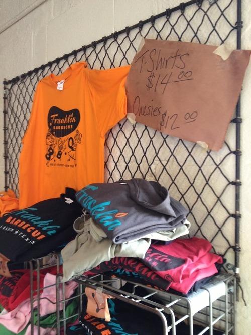 Merchandise, including BBQ onesies.