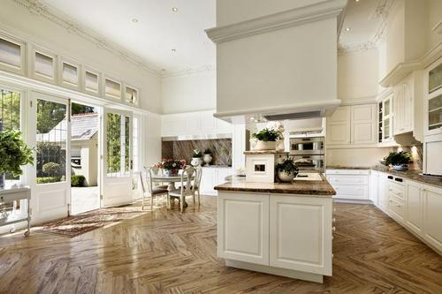 Transom windows above patio doors, parquetry floor would be original