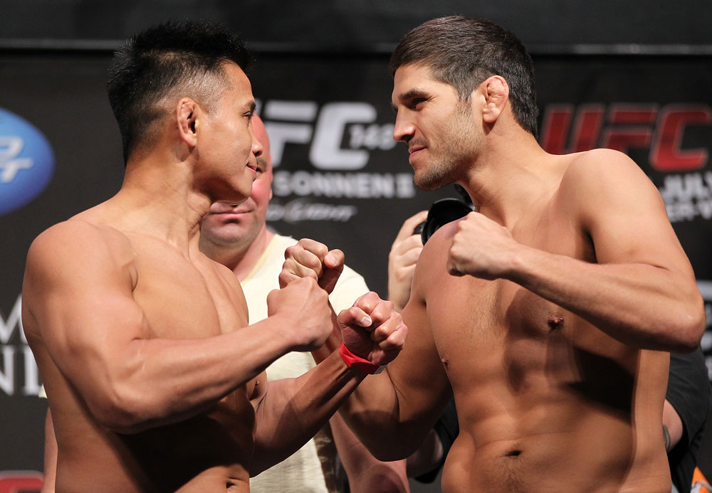 LAS VEGAS, NV - JULY 6:   (L-R) Opponents Cung Le and Patrick Cote face off during the UFC 148 Weigh In at the Mandalay Bay Events Center on July 6, 2012 in Las Vegas, Nevada.  (Photo by Josh Hedges/Zuffa LLC/Zuffa LLC via Getty Images)