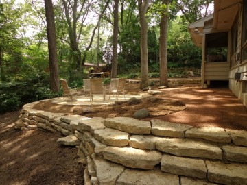 New outcropping wall with flagstone patio in distance