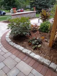 Concrete paver detail with limestone cobbles