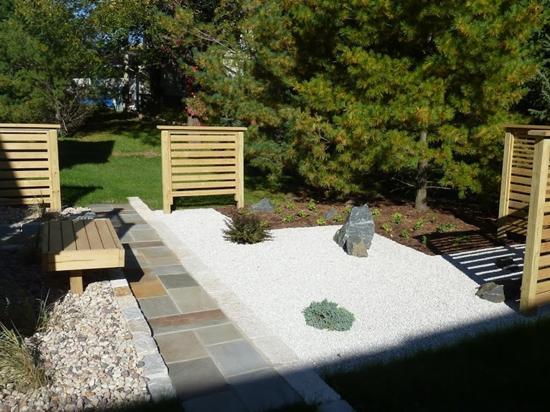 Dwarf Spruce and Barberry within gravel garden