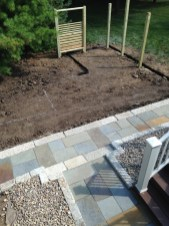 Gravel garden layout with trellis