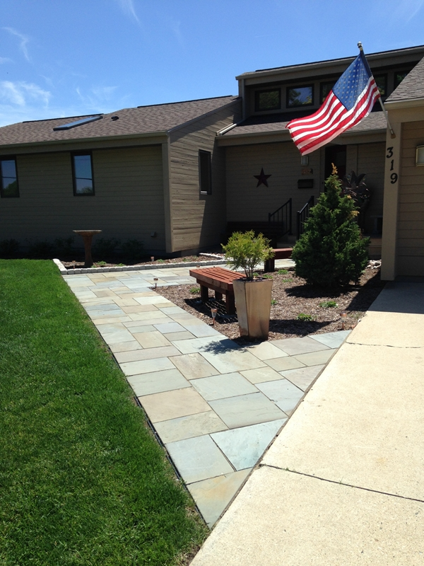 Bluestone pavers adjacent to concrete drive.