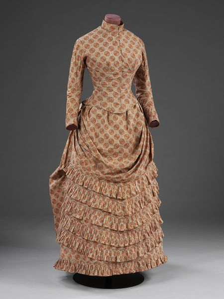 Tiered and bustled skirt from 1885. Victoria & Albert Museum.