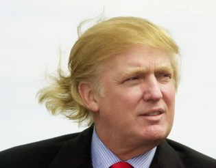 """Trump at an outdoor event in around 2000, after ordering his stylist to color his hair and eyebrows a then-chic shade known as """"Cigar-Stained-Teeth Blonde."""" Tellingly, the wind affects but a single quadrant of Trump's hair, as if the rest were bolted down like a storm cellar door."""