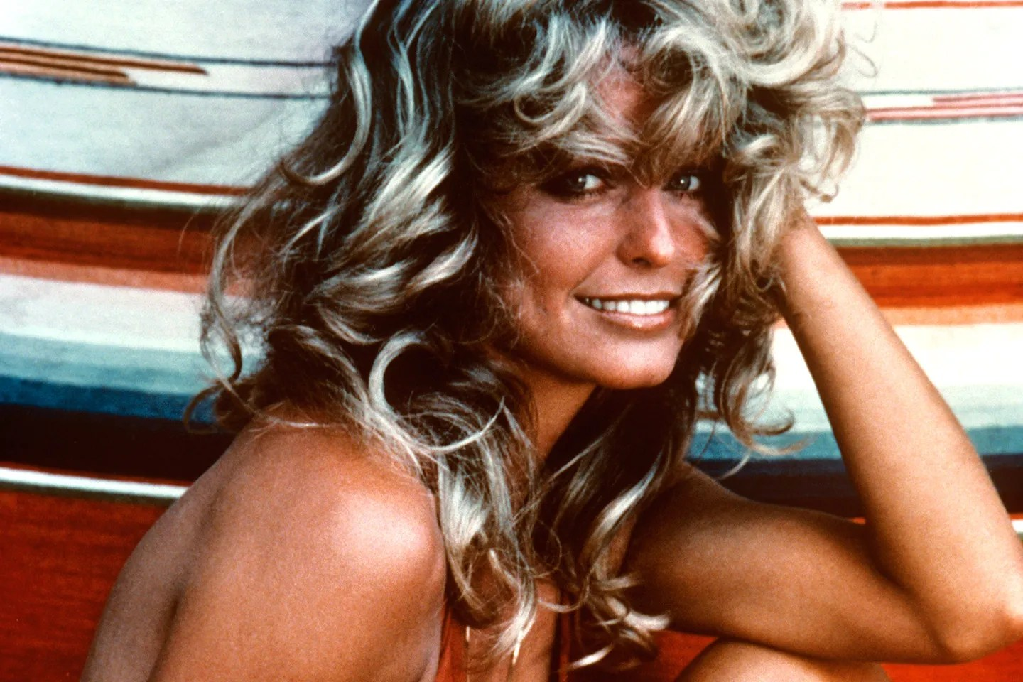 Image result for image of farrah fawcett smiling red bathing suit