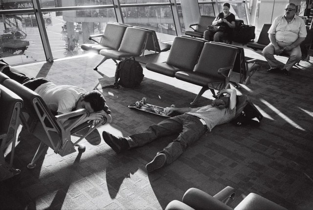 """__BAKU, AZERBAIJAN__  A layover in Baku, Azerbaijan, with his friends Daryl Angel and Donovan Pisocopo on one of their frequent skateboarding trips. """"This really defines what we were feeling about our travels at the time. Too tired to abide by the rules of the chair . . . we were just done."""""""