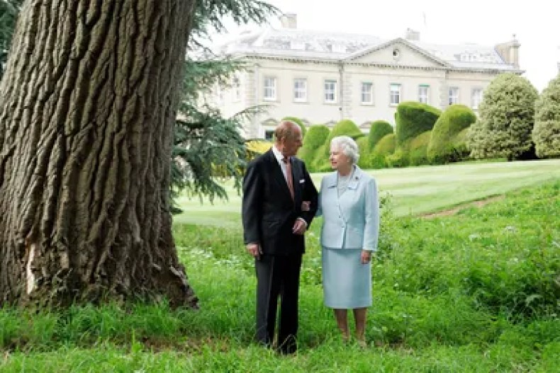 This image may contain Human Person Plant Grass Clothing Apparel Elizabeth II Tree Suit Coat and Overcoat