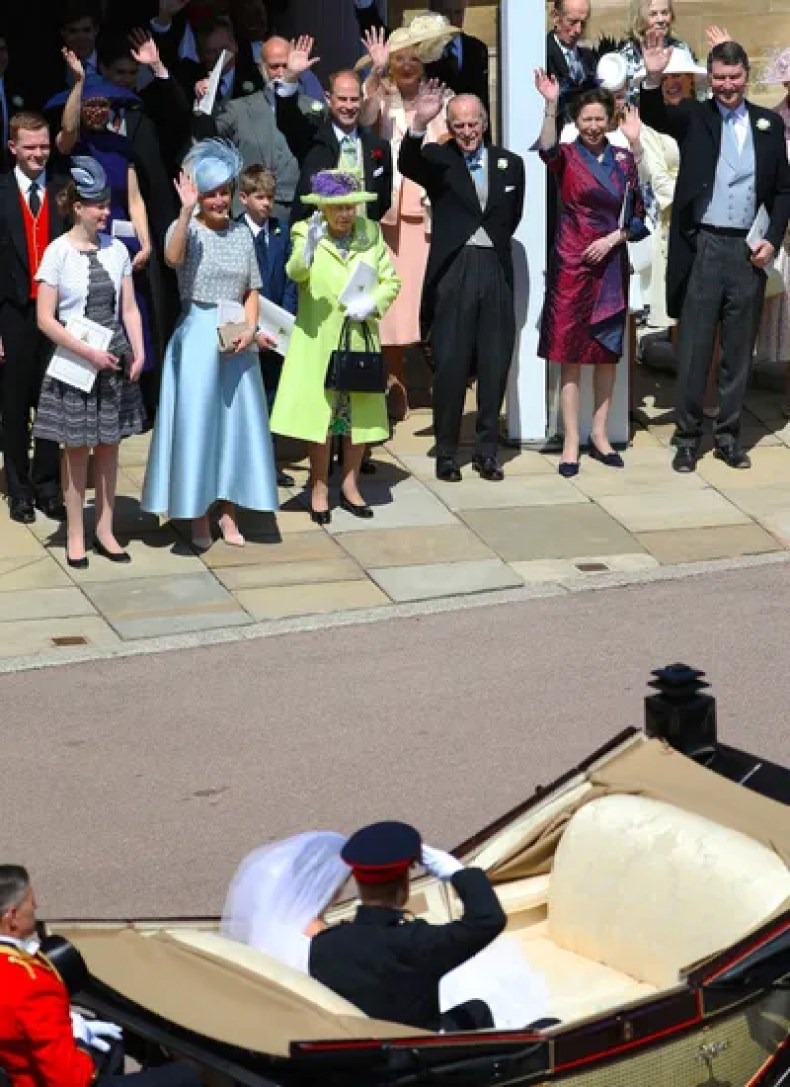 Waving adieu to newlyweds Prince Harry Duke of Sussex and Meghan Markle Duchess of Sussex after their wedding in St...