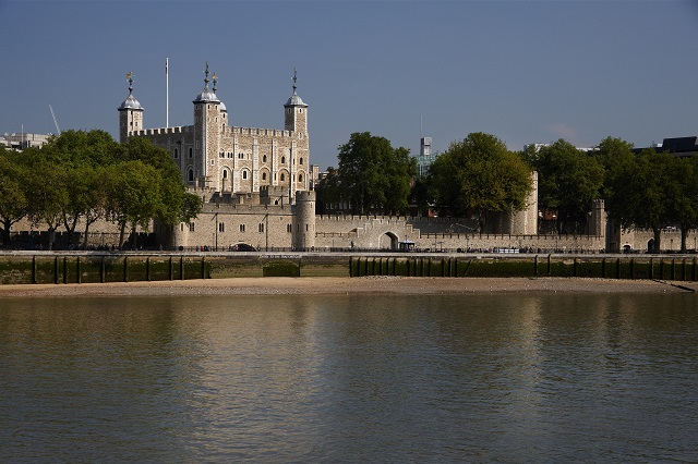 The Tower of London is a historic royal palace, former prison and fortress and national landmark on the banks of the River Thames in London. The White tower. UNESCO world heritage site. View of the palace from across the river, from the South Bank river walk.