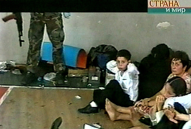 A video grab shows a militant with hostages in the gym of the school in Beslan, Russia, which was shot by the militants during the siege. Russia's NTV television showed graphic footage shot by the militants.