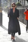 Victoria Beckham used a few skinny jeans along with a trench coat