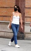 Katie Holmes in jeans and strapless white top