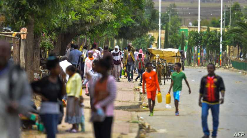 People walk on July 6, 2019 in the streets of Zalambessa, a town where battered buildings highlight the damage wrought by the Ethiopia-Eritrea border war, which erupted in 1998 and left tens of thousands of people dead.