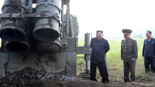 FILE - North Korean leader Kim Jong Un attends the testing of a super-large multiple rocket launcher in North Korea, in this undated photo released Sept. 10, 2019 by North Korea's Korean Central News Agency.