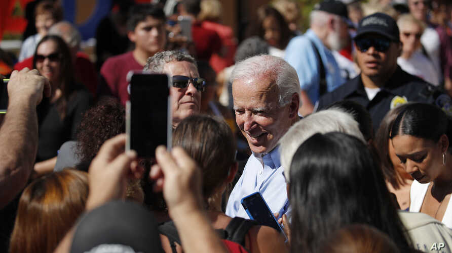 Democratic presidential candidate former Vice President Joe Biden meets with people at a campaign event, Sept. 27, 2019, in Las Vegas.