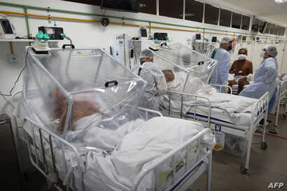 Health workers and patients remain in the Intensive Care Unit for COVID-19 of the Gilberto Novaes Hospital in Manaus, Brazil,