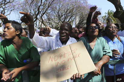 Zimbabwean medical staff march on the streets of Harare, Thursday Sept. 19, 2019. Zimbabwean doctors protesting the alleged abduction of a union leader won a High court ruling allowing them to march and handover a petition to the parliament.The…