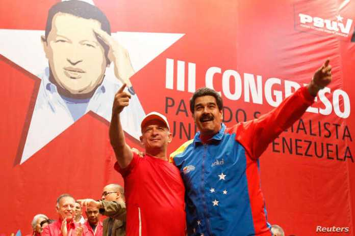 Venezuela's President Nicolas Maduro (R) embraces retired General Hugo Carvajal as they attend the Socialist party congress in