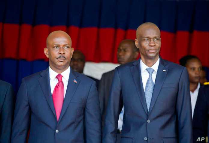 Haiti's President Jovenel Moise, right, stands with resigning prime minister Jean Michel Lapin, at the national palace during a ceremony marking the 216th anniversary of the Battle of Vertieres in Port-au-Prince, Haiti, Nov. 18, 2019.