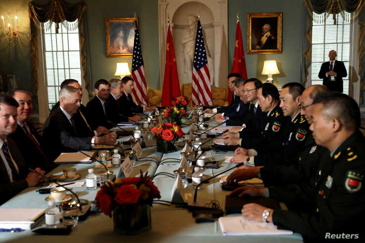FILE - U.S. and Chinese officials are seen meeting during the second bilateral Diplomatic and Security Dialogue, at the State Department in Washington, Nov. 9, 2018.