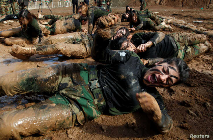 Members of Kurdish Peshmerga Special Forces demonstrate their skills during their graduation ceremony at a military camp in Soran district, in Erbil province, Iraq.