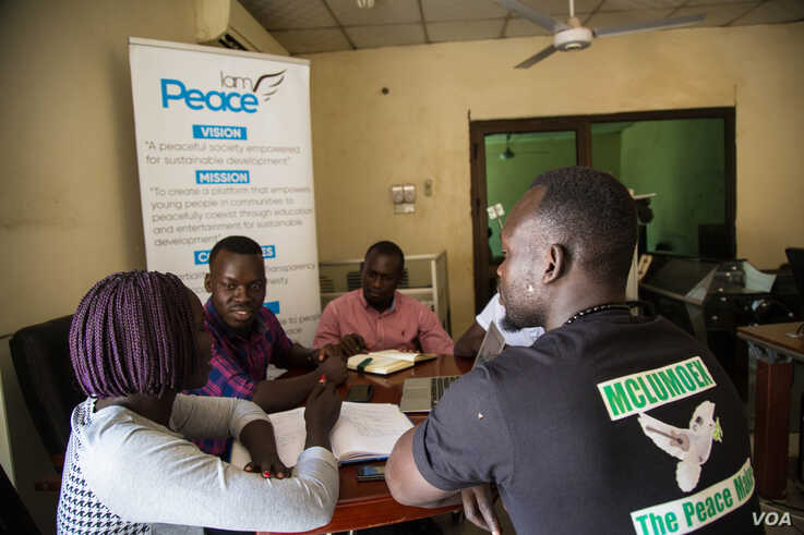 Lupai Samuel Stephen, director of an organization called I Am Peace Initiative, sits with his team to organize the upcoming Peace Camp program in Juba, South Sudan. (Chika Oduah/VOA)